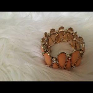 Lovely piece golden / orange salmon colored stones